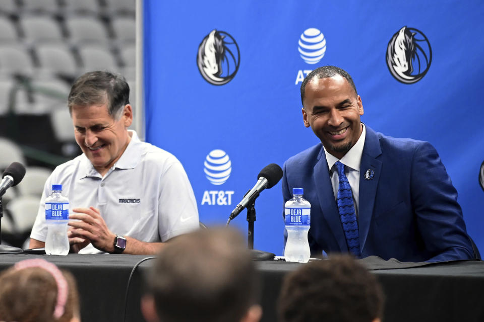 Dallas Mavericks NBA basketball team owner Mark Cuban, left, laughs with new general manager Nico Harrison during a press conference formally introducing Harrison and Jason Kidd, not shown, as head coach, Thursday, July 15, 2021, in Dallas. (AP Photo/Matt Strasen)