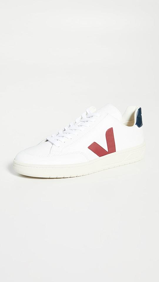 """<p>These sleek <a href=""""https://www.popsugar.com/buy/Veja-V-12-Leather-Sneakers-579526?p_name=Veja%20V-12%20Leather%20Sneakers&retailer=eastdane.com&pid=579526&price=140&evar1=savvy%3Aus&evar9=44104053&evar98=https%3A%2F%2Fwww.popsugar.com%2Fsmart-living%2Fphoto-gallery%2F44104053%2Fimage%2F47527857%2FVeja-V-12-Leather-Sneakers&list1=shopping%2Cgifts%2Choliday%2Cgift%20guide%2Cgifts%20for%20men%2Cshoppable&prop13=mobile&pdata=1"""" rel=""""nofollow"""" data-shoppable-link=""""1"""" target=""""_blank"""" class=""""ga-track"""" data-ga-category=""""Related"""" data-ga-label=""""https://www.eastdane.com/leather-sneakers-veja/vp/v=1/1572446841.htm?folderID=23370&amp;colorId=10DD8"""" data-ga-action=""""In-Line Links"""">Veja V-12 Leather Sneakers</a> ($140) are a serious upgrade from his classic white sneakers.</p>"""
