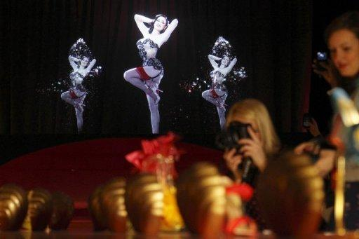 A 3D hologram of a burlesque dancer at a preview of an exhibition by French shoe designer Christian Louboutin showcases 20 years of the famous red-soled shoes at the Design Museum in London