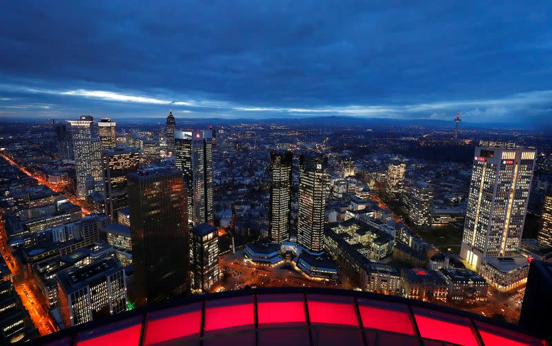 The financial district with the headquarters of Germany's largest business bank, Deutsche Bank (C), is photographed on early evening in Frankfurt
