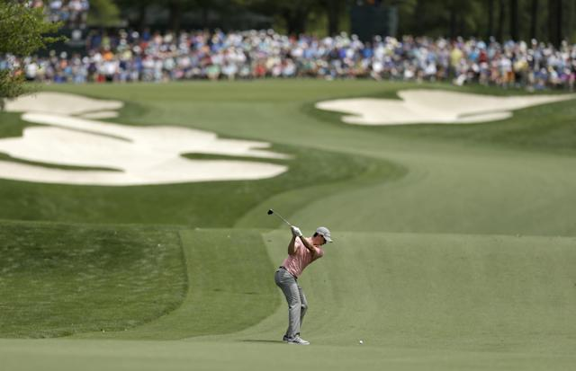 Justin Rose, of England, prepares to hit his approach shot to the fifth green during the first round of the Wells Fargo Championship golf tournament in Charlotte, N.C., Thursday, May 1, 2014. (AP Photo/Chuck Burton)