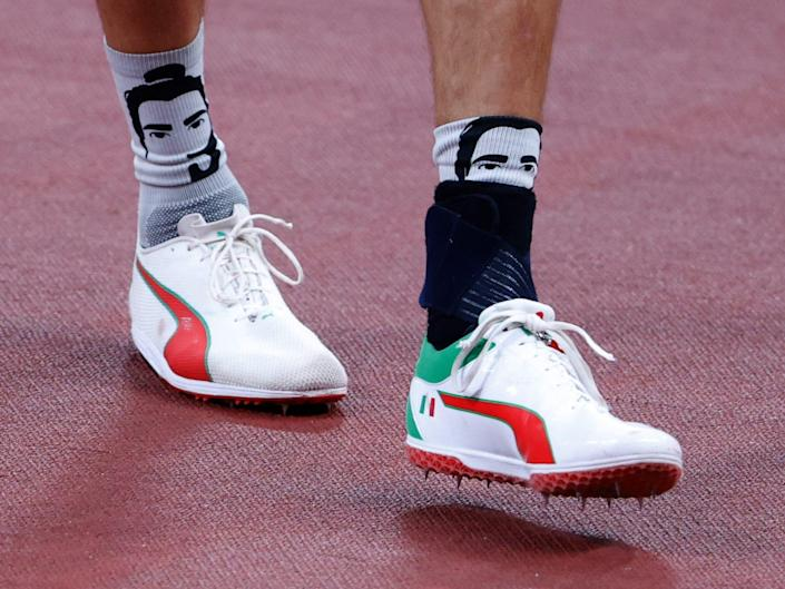 Gianmarco Tamberi wears socks with his face on them.