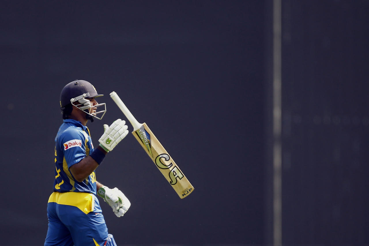 Sri Lanka's Kusal Perera walks back to pavilion after his dismissal by Bangladesh's Rubel Hossain during the second one day international (ODI) cricket match between them in Dhaka, Bangladesh, Thursday, Feb. 20, 2014. (AP Photo/A.M. Ahad)