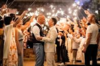 <p>Jeffrey and Chris got engaged on Thanksgiving while vacationing in Thailand. They wed on July 5, 2019 in front of family and friends (with sparklers!) in California. The event took quite a turn when a 7.1 earthquake struck during the dining portion of the evening, but that didn't stop the grooms and their guests from celebrating.</p>