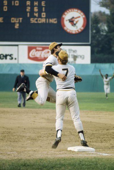 """<p><strong>October 17, 1971</strong>: Like every other 8-year-old kid, Steve Blass dreamed of how he'd react after recording the final out of a World Series. In Game 7 of the 1971 Fall Classic, he found out. The Pirates pitcher allowed one run against the Orioles in his second complete-game victory of the series. When Merv Rettenmund grounded out to end the game, Blass leapt into the air, dashed toward first base and hugged first baseman Bob Robertson. """"There are certain end-of-World Series images that come to mind,"""" said Puerzer. """"It's an occupation for these guys, but it's also something they can be so joyful about."""" As Blass put it, """"You just react. It's raw nerve. It's absolutely pure, and it stays pure the rest of your life.""""<br> </p>"""