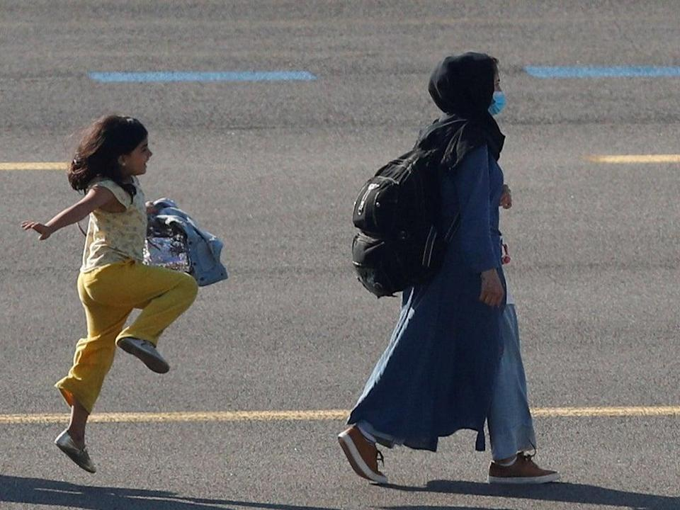 The picture of the girl was taken by Reuters photographer Johanna Geron at a military airport near Brussels earlier this week  (REUTERS)