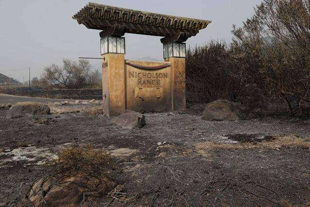 <p>The entrance sign to Nicholson Ranch vineyards, which was consumed by fires in Sonoma, Calif., Oct. 10 2017. (Photo: John G. Mabanglo/EPA-EFE/REX/Shutterstock) </p>
