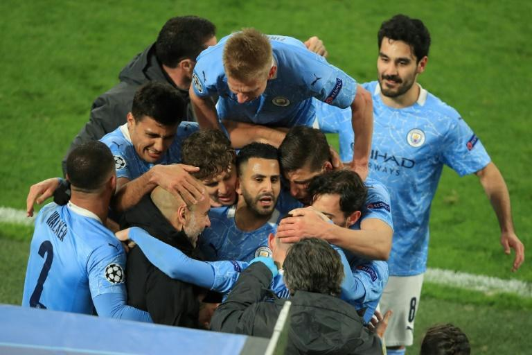 Manchester City players celebrate Phil Foden's winner in a 2-1 victory over Borussia Dortmund to reach the Champions League semi-finals