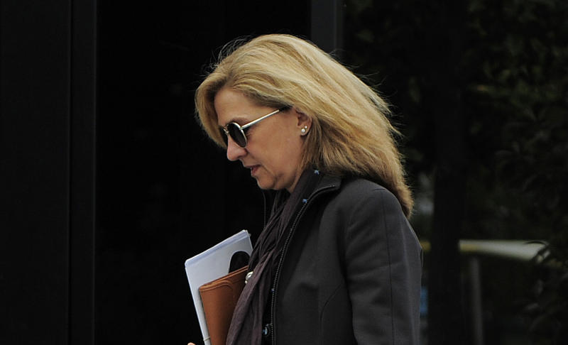 In this April 5, 2013 file photo, Spain's Princess Cristina walks toward her office in Barcelona, Spain. In an unprecedented court appearance on Saturday Feb. 8, 2014 for a direct descendent of a Spanish king, Princess Cristina will answer questions from a judge who has formally named her as a fraud and money laundering suspect. The case is a direct offshoot of one led by the same judge in an investigation of her husband Inaki Urdangarin for allegedly using his position as the Duke of Palma to embezzle public contracts via the Noos Institute, a supposedly nonprofit foundation he set up that channeled money to other businesses. Spain's royal family just wants the case that has now dragged on for years to end rapidly so the monarchy can try to rebuild the trust it once had. (AP Photo/Manu Fernandez, File)