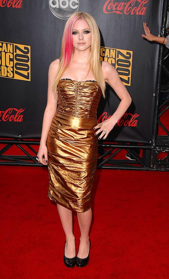 "Punk/pop star Avril Lavigne's gold dress looks like Christmas wrapping paper. Steve Granitz/<a href=""http://www.wireimage.com"" target=""new"">WireImage.com</a> - September 16, 2007"