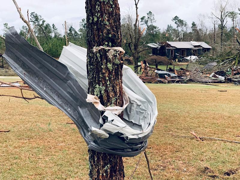 A piece of metal is seen wrapped around a tree following a tornado in Beauregard, Alabama, U.S. in this March 3, 2019 still image obtained from social media video on March 4, 2019. (Photo: Scott Fillmer /via Reuters)