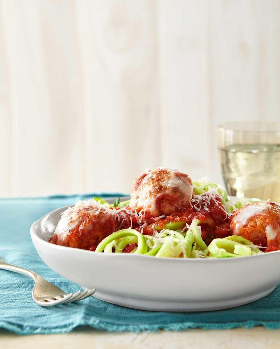 """<p>Lighten up classic meatballs and spaghetti with ground turkey and simply dressed zoodles.</p><p><em><a href=""""https://www.countryliving.com/food-drinks/recipes/a39371/turkey-meatballs-over-zucchini-noodles-recipe/"""" rel=""""nofollow noopener"""" target=""""_blank"""" data-ylk=""""slk:Get the recipe from Country Living »"""" class=""""link rapid-noclick-resp"""">Get the recipe from Country Living »</a></em></p>"""