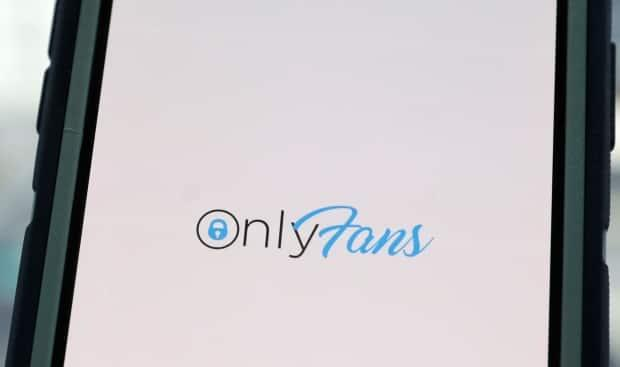The OnlyFans app — a site where subscribers can pay creators for their photos and videos — is shown on a phone screen. OnlyFans will ban 'sexually explicit' content on its platform starting Oct. 1, after requests from banking partners. Those in the industry say it's just the latest overreaching response in a war against adult content online. (Andrew Kelly/Reuters - image credit)