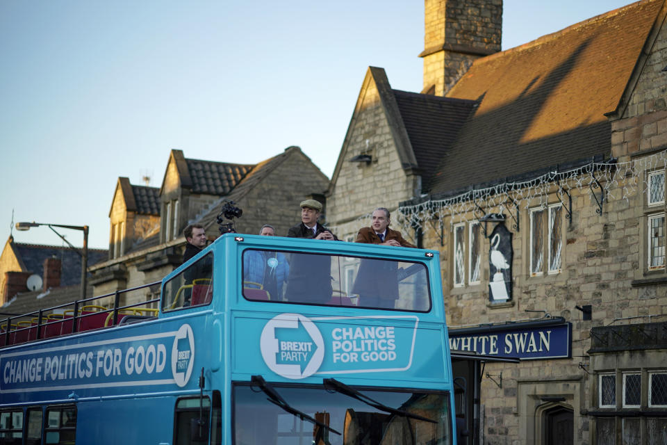 BOLSOVER, ENGLAND - DECEMBER 03: Brexit Party leader Nigel Farage (C) campaigns on the party battle  bus in Bolsover during election campaigning on December 03, 2019 in Bolsover, England.  Political parties continue to campaign around the country as Britain prepares to go to the polls on December 12, 2019 to vote in a pre-Christmas general election. (Photo by Christopher Furlong/Getty Images)
