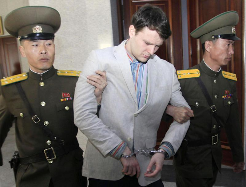 American student Otto Warmbier, center, is escorted