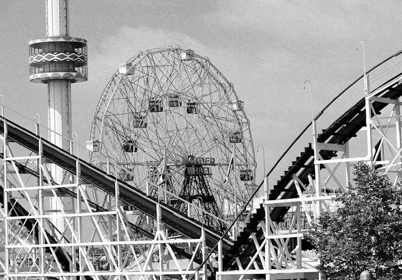 FILE- In this June 30, 1977 file photo, the 275-foot tall Astrotower , left, reaches into the sky along with the 150-foot-tall Wonder Wheel, and the Cyclone roller coaster snakes through the foreground at the Astorland amusement park in the Coney Island section of the Brooklyn borough of New York. The iconic Coney Island amusement park was evacuated, Tuesday, July 2, 2013 after reports that the Astrotower observation tower was swaying in the wind. (AP Photo, File)