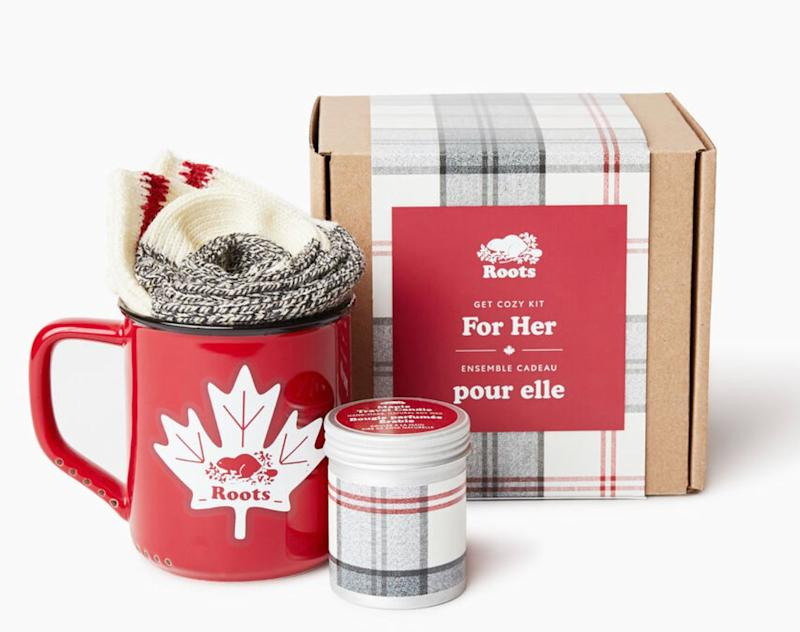 """This kit has everything you need to stay cosy this winter: socks, a mug, and a maple-scented candle. Get it at <a href=""""https://www.roots.com/ca/en/get-cozy-kit-for-her-45030274.html?cgid=NewForGeneralStore&amp;start=1&amp;selectedColor=Y99&amp;itemsourse=productlist"""" target=""""_blank"""" rel=""""noopener noreferrer"""">Roots</a> for $32."""