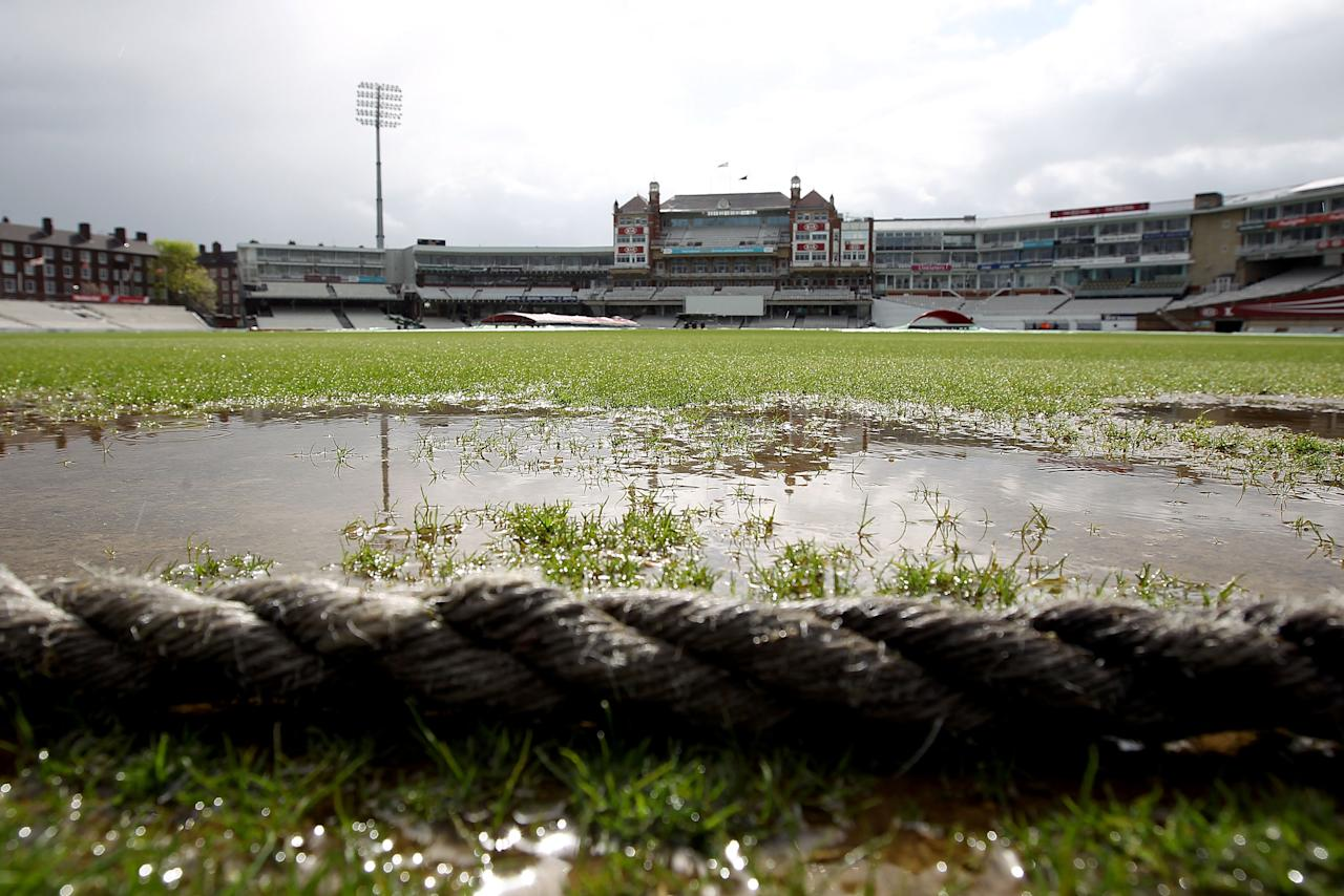 LONDON, ENGLAND - APRIL 26:  Flooding on the outfield is seen as poor weather conditions delay the start of the LV County Championship between Surrey and Durham at The Kia Oval on April 26, 2012 in London, England.  (Photo by Clive Rose/Getty Images)