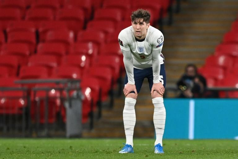 England defender John Stones reacts after his error led to Poland's equaliser in their World Cup qualifier at Wembley