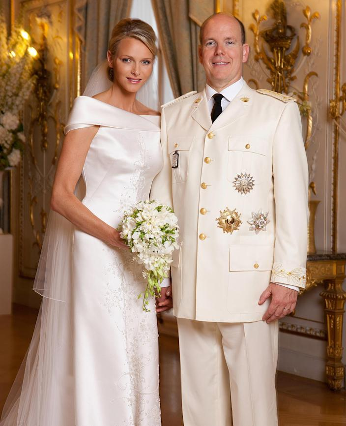 <p>Charlene's handmade gown for her religious wedding ceremony had been announced six months earlier by Giorgio Armani. Made from 425 feet of white silk, the robe featured a 66-foot veil and train, embroidered with 60,000 crystals and mother of pearl teardrops. Despite its intricacies, it showed off Charlene's athletic figure with classical simplicity and continues to draw compliments for its modernity.</p>