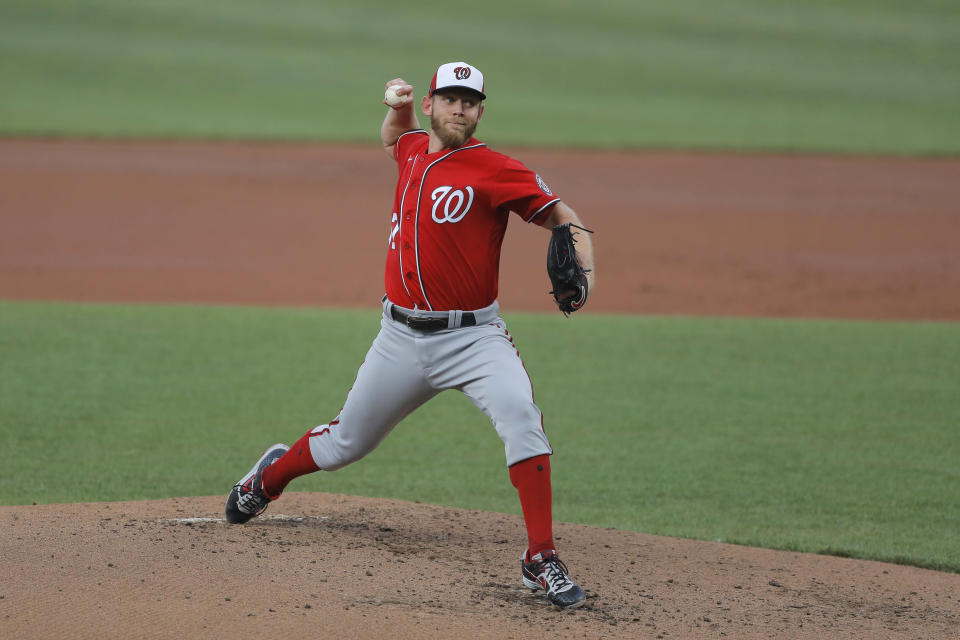 FILE - In this July 20, 2020 file photo, Washington Nationals starting pitcher Stephen Strasburg delivers a pitch to the Baltimore Orioles during an exhibition baseball game in Baltimore. Strasburg has been scratched from what was supposed to be his first start of the season for the Washington Nationals because of a nerve issue with his right hand. Nationals manager Dave Martinez announced the news about four hours before the scheduled first pitch against the visiting New York Yankees on Saturday, July 25. (AP Photo/Julio Cortez, File)