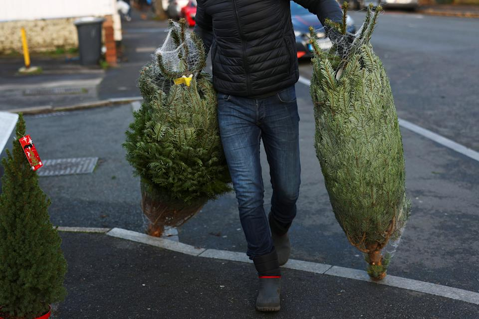 Workers at Mistletoe and Pine set up a Christmas tree stand, amid the coronavirus disease (COVID-19) outbreak in the Dulwich area of London, Britain, November 22, 2020. REUTERS/Simon Dawson