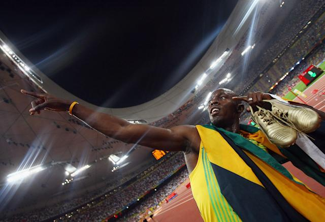 BEIJING - AUGUST 22: (EDITORS NOTE: A special effects camera filter was used for this image.) Usain Bolt of Jamaica celebrates after running the final leg in the Men's 4 x 100m Relay Final at the National Stadium on Day 14 of the Beijing 2008 Olympic Games on August 22, 2008 in Beijing, China. (Photo by Alexander Hassenstein/Bongarts/Getty Images)