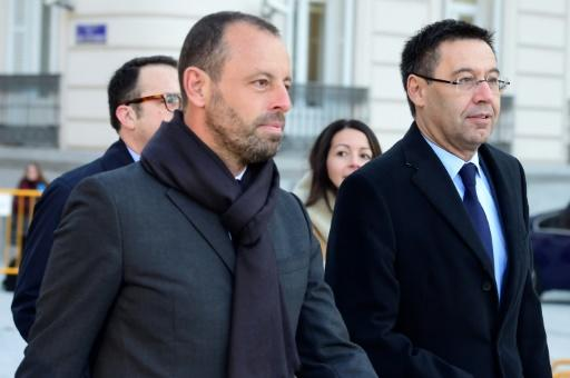 FC Barcelona's former president Sandro Rosell (L), pictured in February 2016, acted as a consultant for Qatar's bid to host the 2022 World Cup, and FIFA allegedly sent $2 million to the bank account of Rosell's 10-year-old daughter
