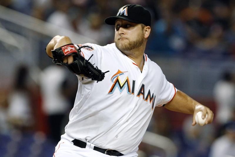 FILE - In this May 26, 2012, file photo, Miami Marlins starting pitcher Mark Buehrle throws in the first inning of a baseball game against the San Francisco Giants in Miami. A person familiar with the deal told The Associated Press on condition of anonymity Tuesday, Nov. 13, that the Marlins have traded Buehrle to the Toronto Blue Jays. (AP Photo/Lynne Sladky)