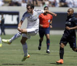 Real Madrid's Gareth Bale, left, scores ahead of Inter Milan's Jonathan, right, during the first half of a soccer match in the first round of the Guinness International Champions Cup, Saturday, July 26, 2014, in Berkeley, Calif. (AP Photo/Ben Margot)