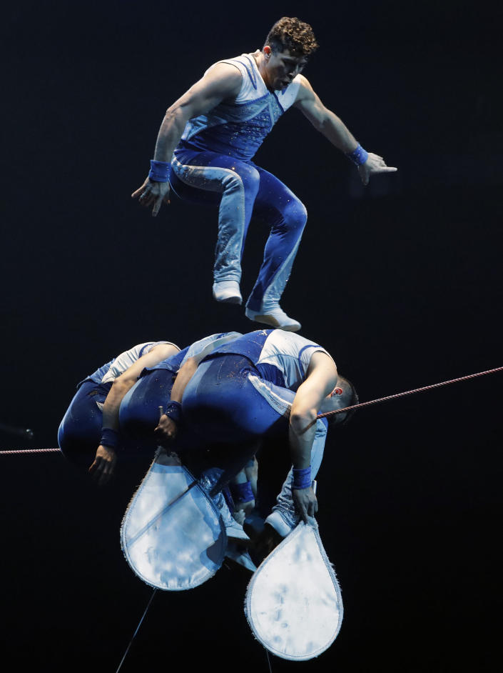"""A Ringling Bros. and Barnum & Bailey acrobat jumps on a high wire during a performance Saturday, Jan. 14, 2017, in Orlando, Fla. The Ringling Bros. and Barnum & Bailey Circus will end the """"The Greatest Show on Earth"""" in May, following a 146-year run of performances. Kenneth Feld, the chairman and CEO of Feld Entertainment, which owns the circus, told The Associated Press, declining attendance combined with high operating costs are among the reasons for closing. (AP Photo/Chris O'Meara)"""
