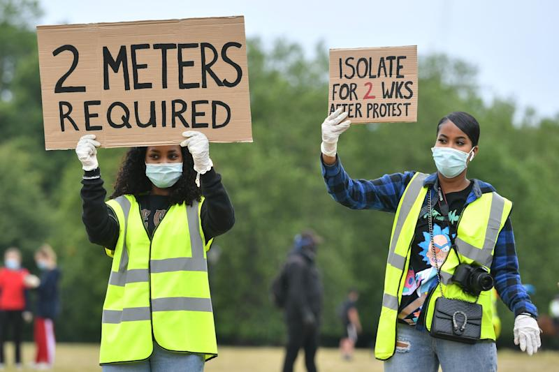 Stewards direct people as they begin to gather ahead of the Black Lives Matter protest rally in Hyde Park, London, in memory of George Floyd who was killed on May 25 while in police custody in the US city of Minneapolis. (Photo: PA)