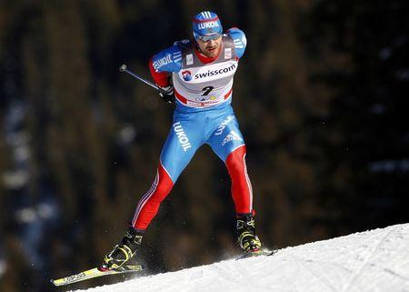 Alexey Petukhov of Russia skis to win the men's cross country individual 1500m sprint free finals at the FIS World Cup in Davos, December 11, 2011. REUTERS/Christian Hartmann