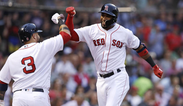Boston Red Sox's Eduardo Nunez, right, is congratulated by Sandy Leon after his solo home run off Los Angeles Angels starting pitcher Andrew Heaney during the second inning of a baseball game at Fenway Park in Boston, Wednesday, June 27, 2018. (AP Photo/Charles Krupa)