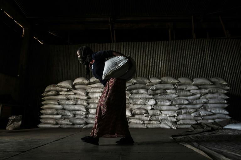 A woman in Alamata carries a sack of wheat during food distribution organised by the Ethiopian government