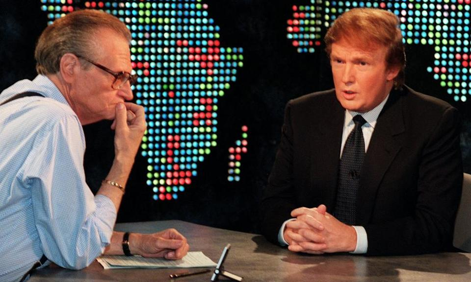 Larry King, left, conducting the 1999 Larry King Live interview during which Donald Trump announced he was considering running to be US president.