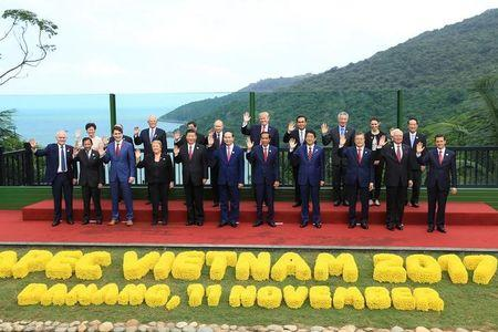 Leaders pose for a group photo at the APEC economic leaders meeting in Danang