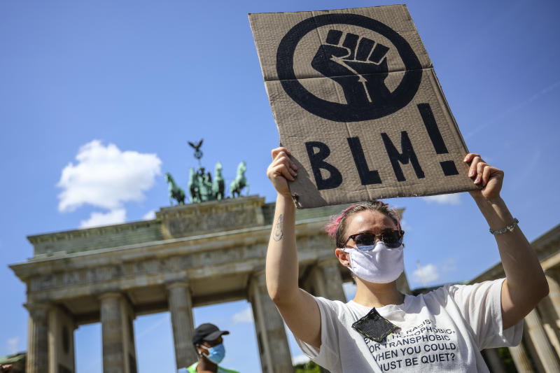 People demonstrate in commemoration of George Floyd near the American embassy at Pariser Platz in Berlin, Germany, May 31, 2020. About 200 people gathered in front of the Brandenburg Gate in the German capital to protest against police brutality racism and hate. 46-year-old African-American, George Floyd died on May 25, 2020 after a Minneapolis police officer was kneeling on his neck for several minutes during his arrest. The controversial act of police brutality sparked violent demonstrations throughout the U.S with reports of riots in Minnesota, California, New-York and more. Reports also mention that Derek Chauvin, one of the police officers allegedly involved in the incident was arrested and will be charged with Third-degree murder. (Photo by: Omer Messinger)