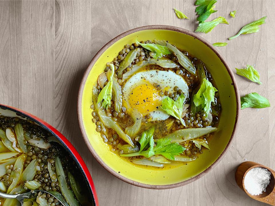 "Pan-searing, then quickly braising celery and garlic in wine and broth turns into a warming meal with the addition of make-ahead marinated lentils. Top it with an egg and add some crusty bread for a surprisingly luxurious, almost all-pantry dish. <a href=""https://www.epicurious.com/recipes/food/views/braised-celery-with-lentils-and-garlic?mbid=synd_yahoo_rss"" rel=""nofollow noopener"" target=""_blank"" data-ylk=""slk:See recipe."" class=""link rapid-noclick-resp"">See recipe.</a>"