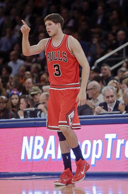 Chicago Bulls' Doug McDermott gestures to a teammate during the first half of an NBA basketball game against the New York Knicks, Wednesday, Oct. 29, 2014, in New York. (AP Photo/Frank Franklin II)