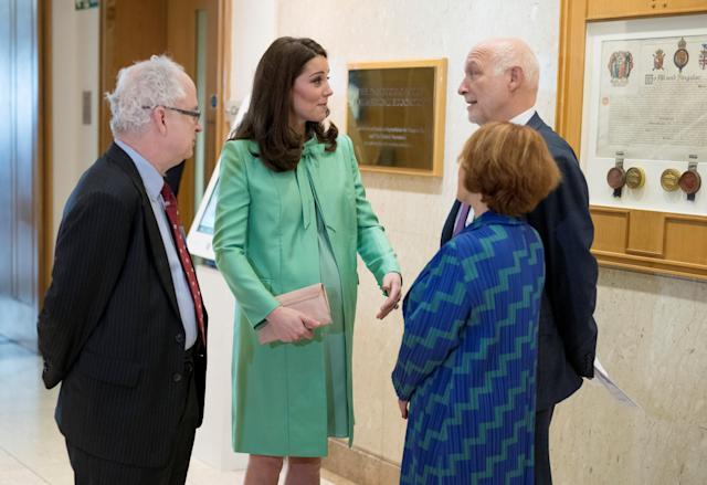 Britain's Catherine, Duchess of Cambridge is greeted by Simon Charles Wessely, President of the Royal society of Medicine, Peter Fonagy, Chief Executive at The Anna Freud Centre and Lorraine Heggessey at the Royal Society of Medicine, in London, Britain March 21, 2018. Geoff Pugh/Pool via Reuters