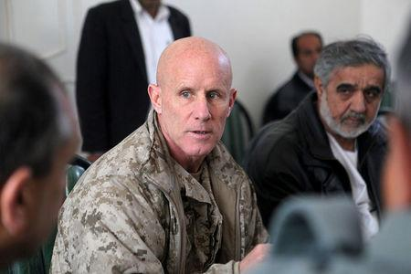 FILE PHOTO: Vice Adm. Robert S. Harward, commanding officer of Combined Joint Interagency Task Force 435, speaks to an Afghan official during his visit to Zaranj, Afghanistan, in this January 6, 2011 handout photo. The visit consisted of a tour of a provincial prison, the Iran/Afghanistan border crossing and an airfield assessment.  Sgt. Shawn Coolman/U.S. Marines/Handout via REUTERS