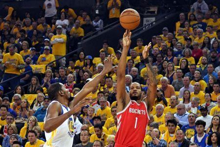 May 26, 2018; Oakland, CA, USA; Houston Rockets forward Trevor Ariza (1) shoots the ball against Golden State Warriors forward Kevin Durant (35) during the first quarter in game six of the Western conference finals of the 2018 NBA Playoffs at Oracle Arena. Mandatory Credit: Kyle Terada-USA TODAY Sports
