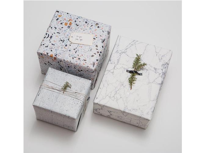"""<p>Yes, we see the irony but the paper-lover in your life will drool over these elegant sheets.</p> <p><a class=""""cta-button-link"""" href=""""https://www.chasingpaper.com/products/marble-gift-wrap"""" target=""""_blank"""">Buy It($10/sheet)</a></p>"""