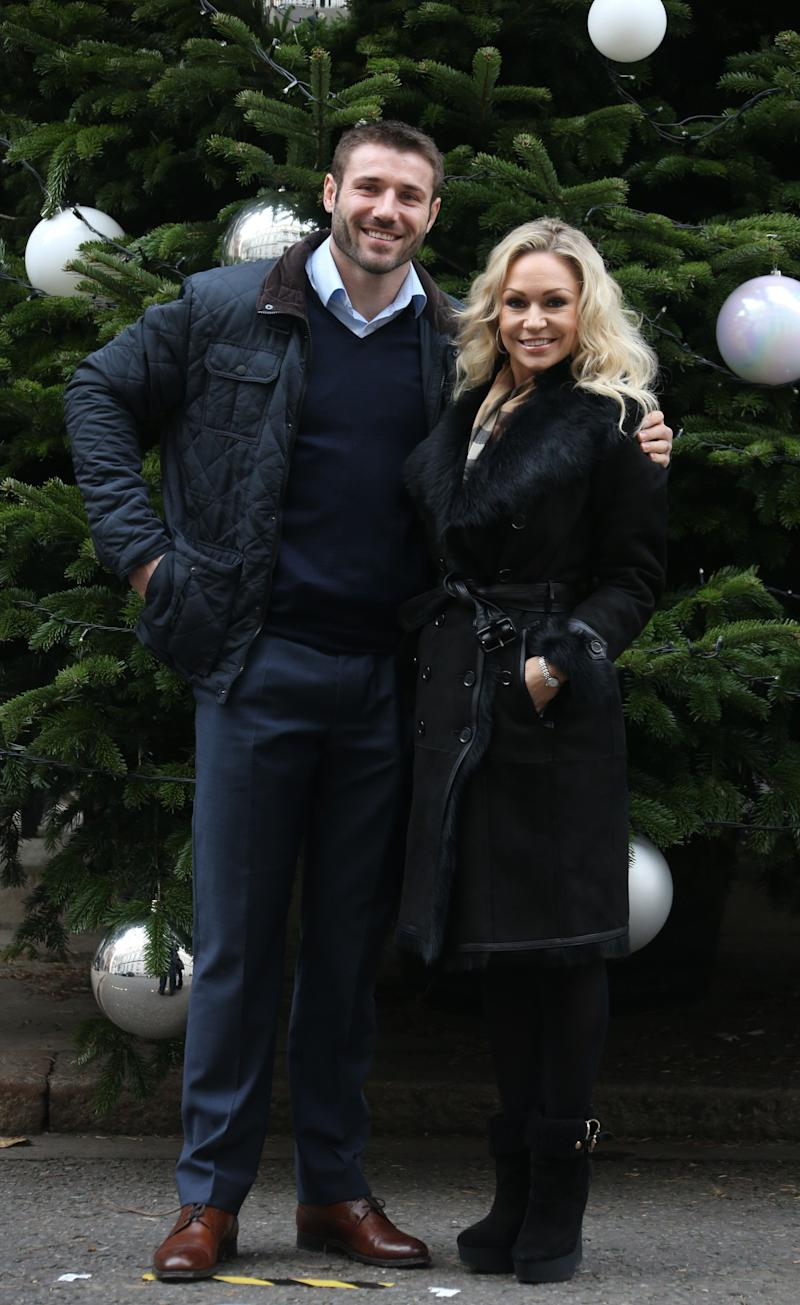 Former England rugby union player Ben Cohen and his Strictly Come Dancing partner Kristina Rihanoff arrive by the Christmas Tree in Downing Street for the Christmas charity parties for number 10 and 11, in central London, Monday, Dec. 9, 2013. (Photo by Joel Ryan/Invision/AP)