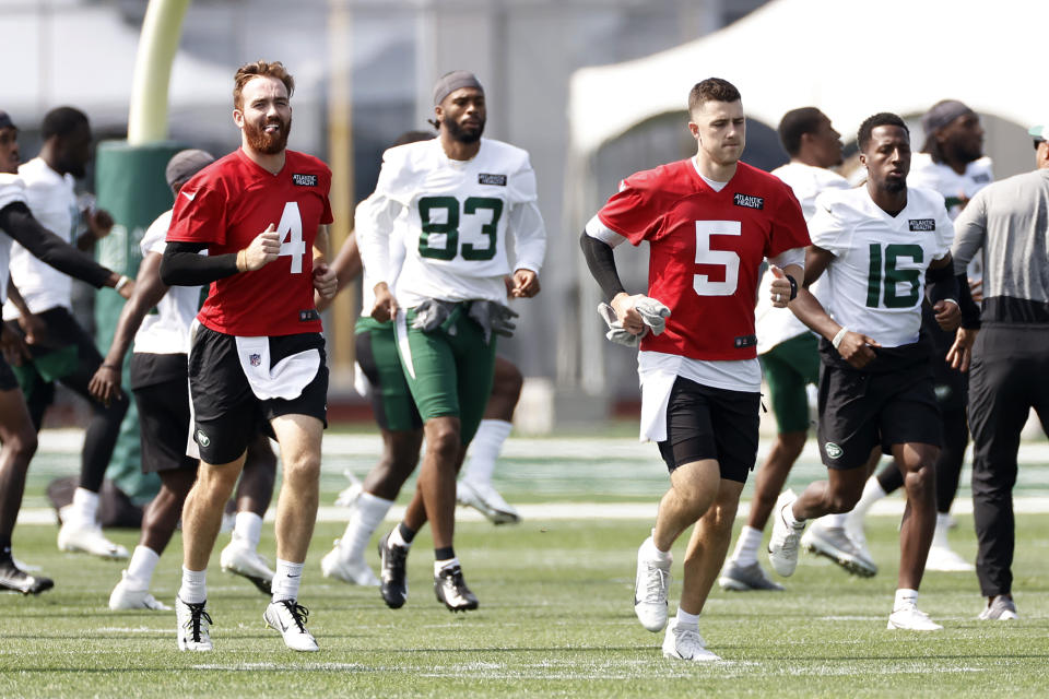 New York Jets quarterbacks James Morgan (4) and Mike White (5) warm up during NFL football practice Wednesday, July 28, 2021, in Florham Park, N.J. (AP Photo/Adam Hunger)