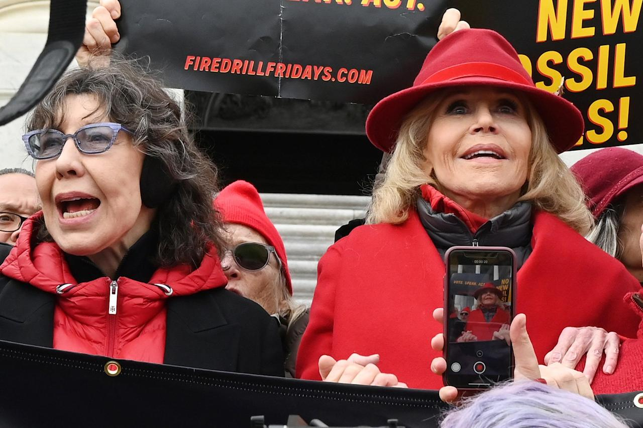 Lily Tomlin and Jane Fonda lead a climate protest in Washington, D.C. on Thursday to call for an end to new fossil fuel exploration.