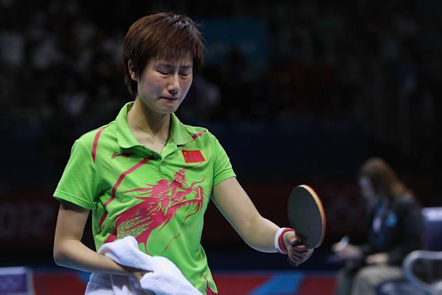 LONDON, ENGLAND - AUGUST 01: Ning Ding of China cries after the Women's Singles Table Tennis Gold Medal match against Xiaoxia Li of China on Day 5 of the London 2012 Olympic Games at ExCeL on August 1, 2012 in London, England. (Photo by Feng Li/Getty Images)