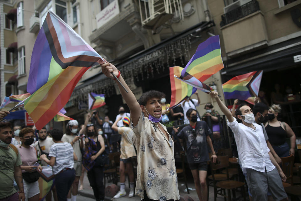 Protesters chants slogans, during a pride event in central Istanbul, Saturday, June 26, 2021. Police used tear gas to disperse the crowds and detained dozens of LGTBI activists as hundreds defied a ban and tried to stage a gay pride event. (AP Photo/Emrah Gurel)