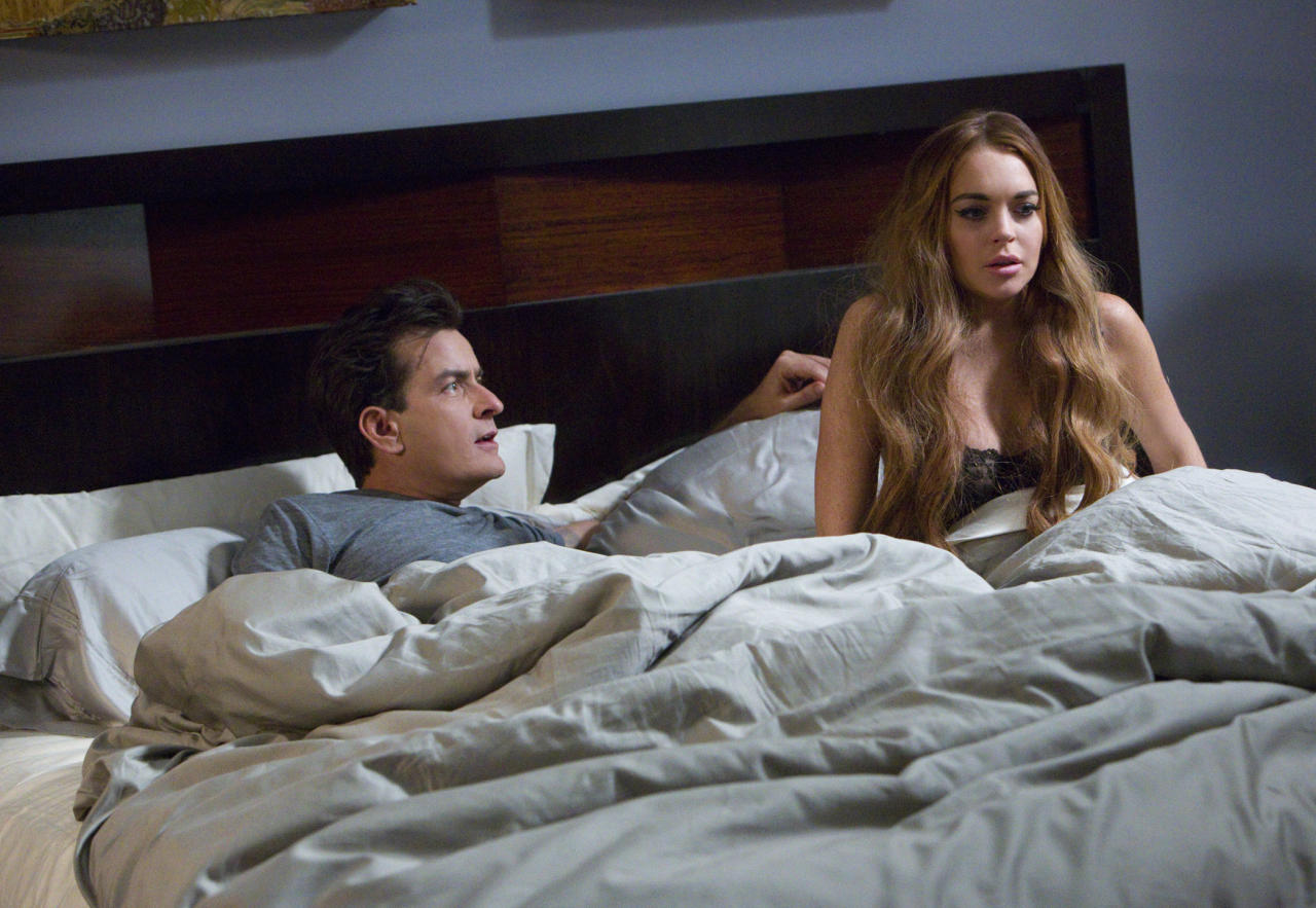 """No, they're not a new couple (how much fun would <em>those</em> headlines be), but Charlie Sheen and Lindsay Lohan jumped into bed together this week to shoot a scene for the upcoming film """"Scream 5."""" Oh, to be a fly on the wall on that set. Did Charlie explain the true meaning of """"winning""""? Did Lindsay share what really happened before her latest arrest? Alas, we'll never know."""